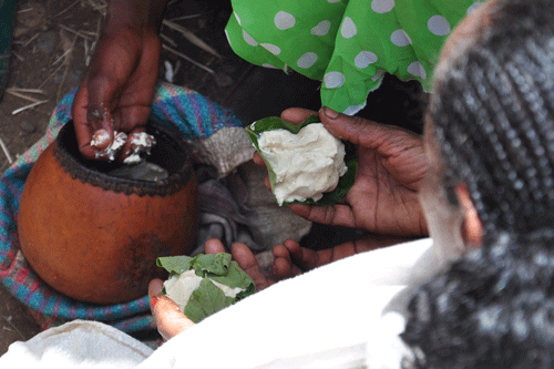 Buying butter at the Axum market