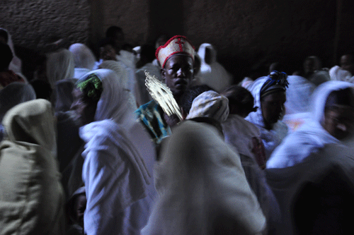 A priest carries the golden cross of Lalibela
