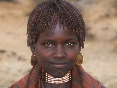 A young Hamer woman in the Omo Valley.