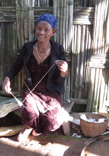 A Dorze woman spins cotton thread.