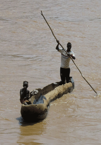 Crossing the Omo River by traditional canoe.