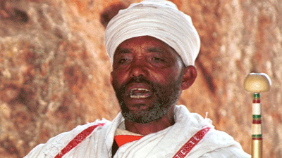 A priest sings church hymns in Lalibela, Ethiopia